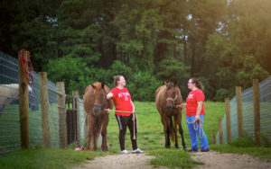 Students walk with horses
