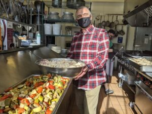 Cover photo for Local Restaurateur Donates Meals Every Week to Help Families