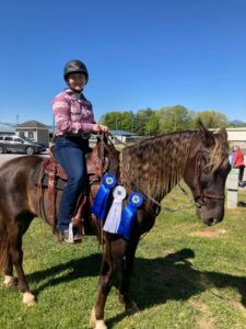 4-H with horse and ribbons